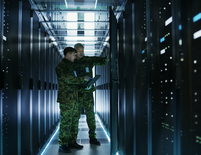 Two military men in a server room